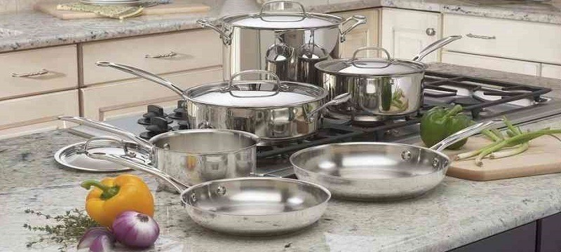 Stainless steel cookware placed on gas stove