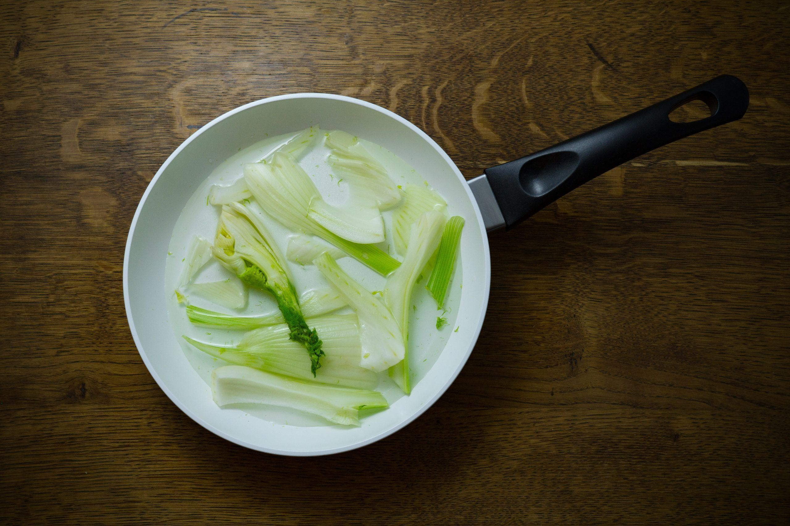green leaves soup in the kitchenware