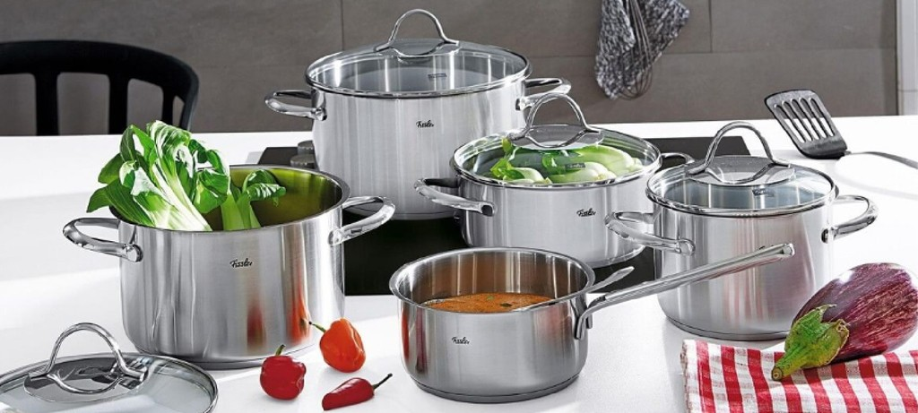 the steel Fissler cookware set sitting on the table with some vegetables around
