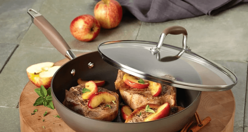 hard anodized brown frying pan with apples