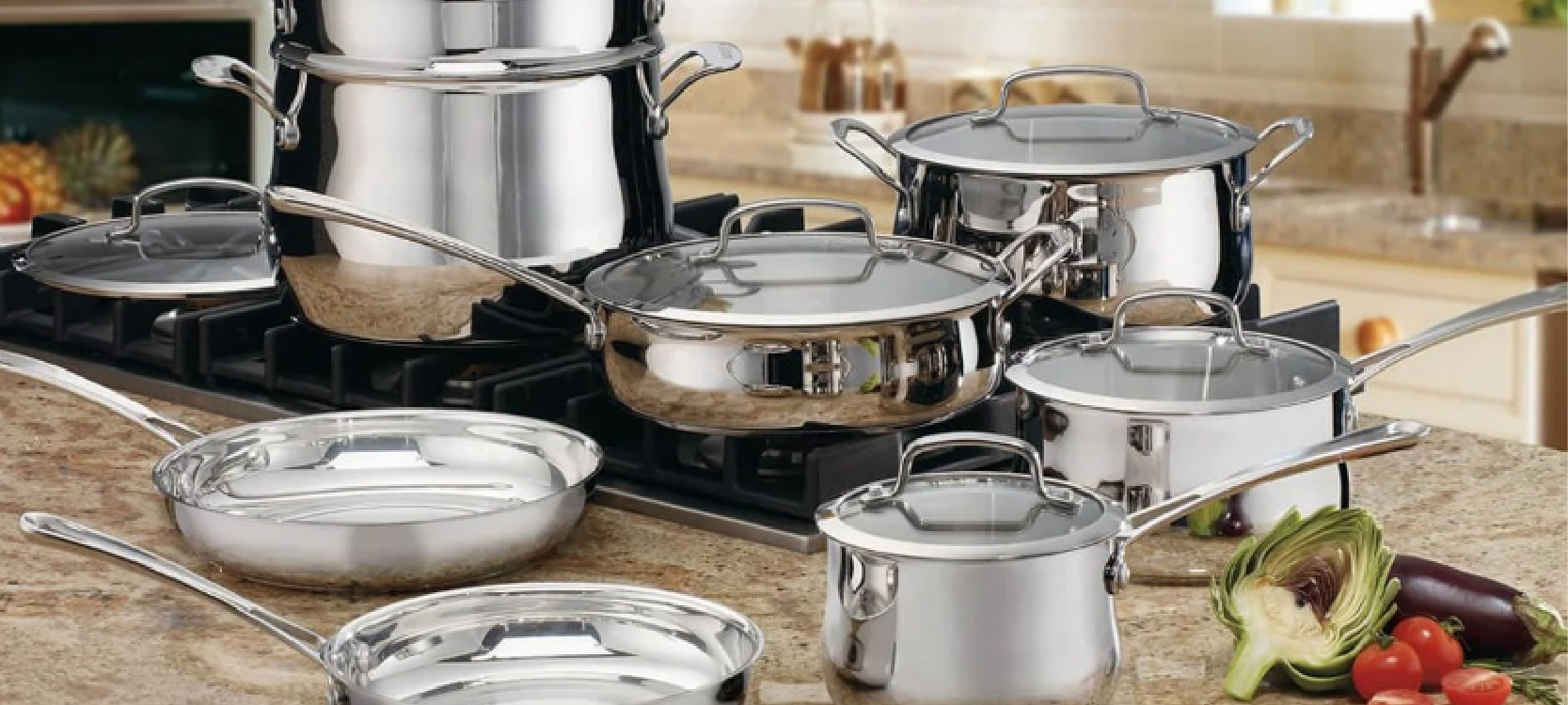 the set of steel duxtop pots and pans lying on the stone kitchen table
