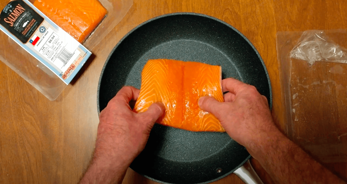 a chef adding the yummy salmon to Bialetti pan
