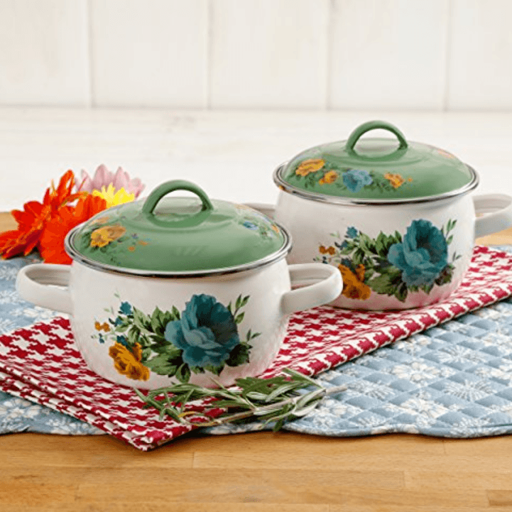 the very beautiful set of ceramic pots with flowers decoration