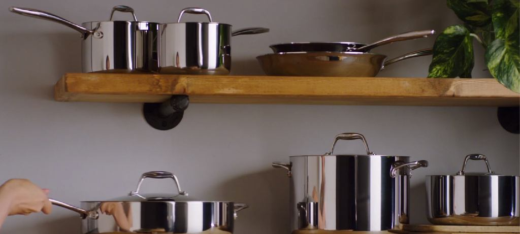 the stainless steel Tramontina set sitting nicely on the wooden shelf