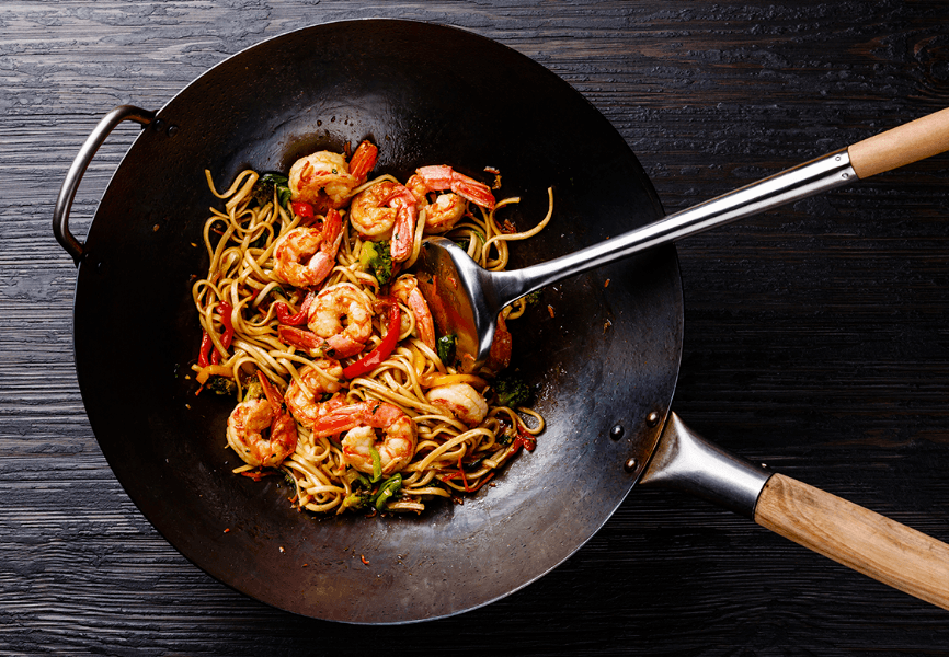 a fried noodles with tiger prawn in wok