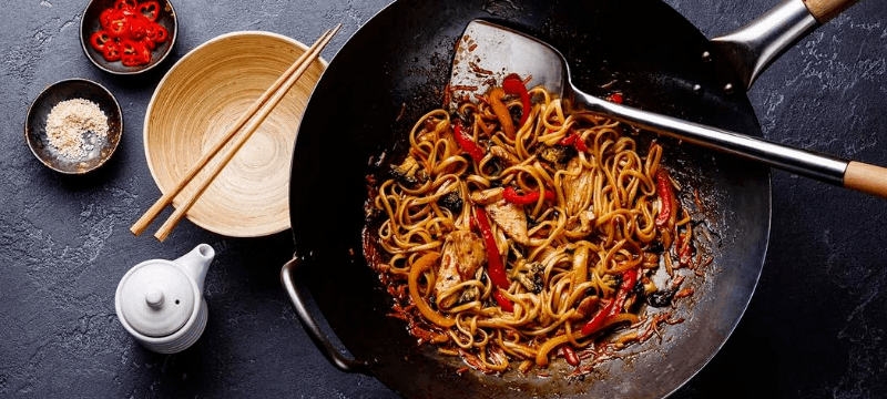 cooking fried noodles in wok