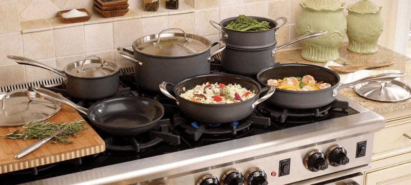 cookware set placed on gas stove