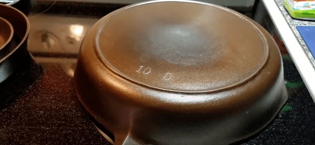 a cast iron pan placed on glass top stove