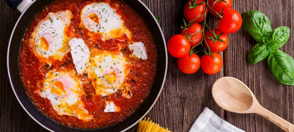 perfect fried egg and tomato sauce in the frying pan