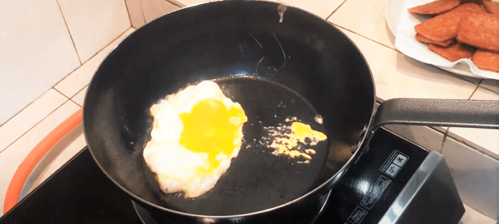 the omlette being fried in the De Buyer pan