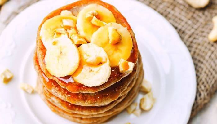 banana pancakes with toppings and syrup