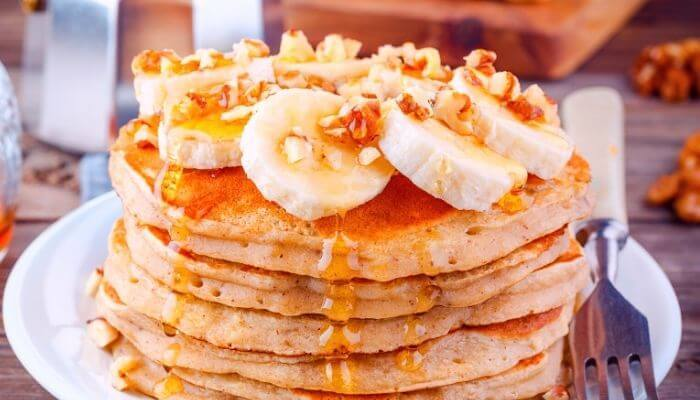 delicious banana pancakes with syrup