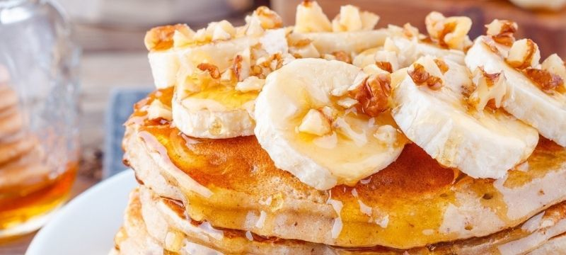 oatmeal banana pancakes with walnuts and syrup