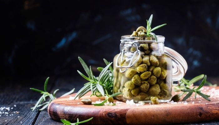 caper jar and rosemary