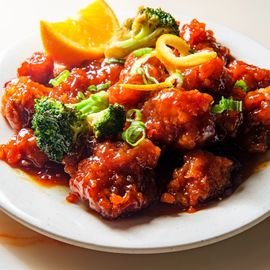 orange chicken plate on table