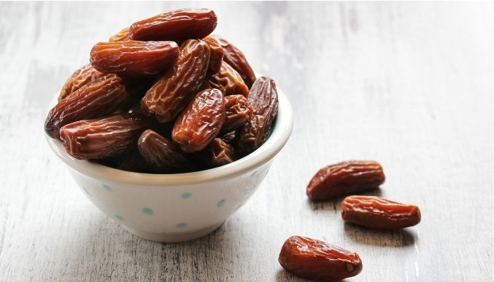 a bowl of dates on tabletop