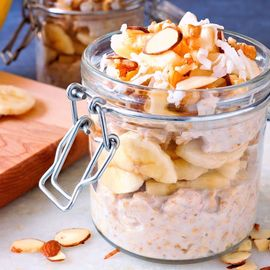 overnight oats with banana and nuts jar on table