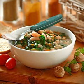sausage and white bean soup on table