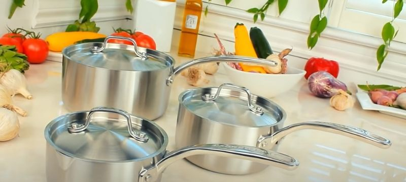 Stainless steel pot and pans on tabletop