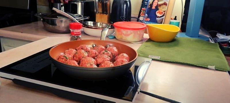 cooking meat ball in pan